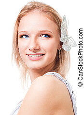 Blond woman with butterfly in her hair smile