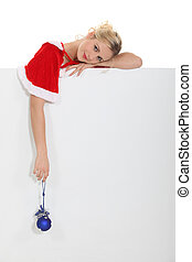 Blond woman with Christmas layer
