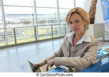Blond woman with computer