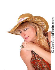 Blond woman with fashion hat.