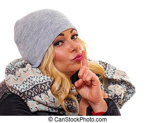 Blond woman with finger to lips.