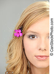 Blond woman with flower in her hair