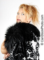 Blond woman with fur