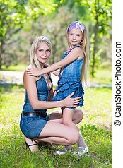 Blond woman with girl