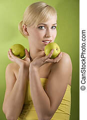 blond woman with green apple