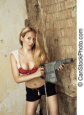 blond woman with heavy drill