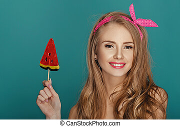 blond woman with lollipop blue background.