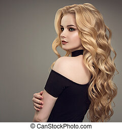 Blond woman with long curly beautiful hair.