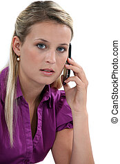 Blond woman with mobile telephone