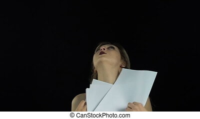 Blond woman with paper sheets