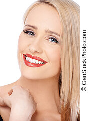 Blond woman with red lipstick smiling