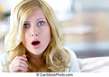 Blond woman with surprised look on her face