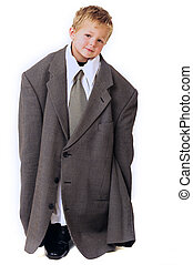 Blond young Boy in oversized business clothes standing