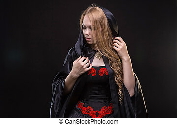 Blond young girl in black cloak