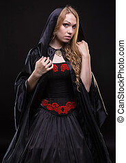 Blond young girl in black hood