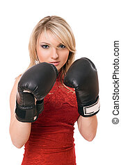 Blond young girl in  boxing gloves