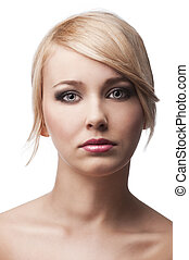 blond young girl with stylish, she is in front of the camera