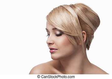 blond young girl with stylish, she's almost turned in profile