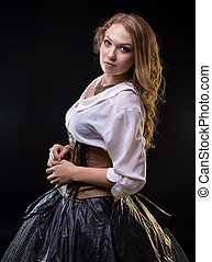 Blond young woman in fantasy dress