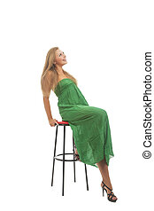 blond young woman in high chair smiling
