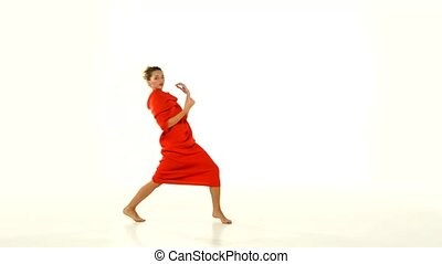Blond young woman showing red long dress-changeling on white background