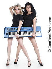 Blonde and brunette with electric piano on a white...