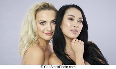 Blonde and brunette young models - Portrait of young pretty...