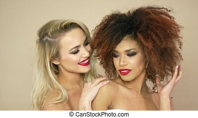 Blonde and curly women in studio - Portrait of two women...