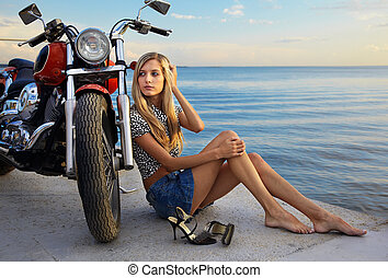 blonde and red motorcycle - young beautiful blonde outdoors,...