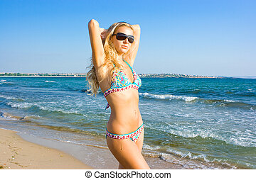 Blonde - Beautiful blonde girl in summer on the sea