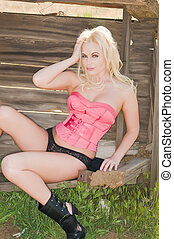 Blonde - Beautiful blonde in a pink corset and black panties