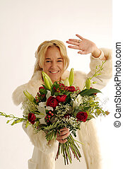 Blonde beautiful bride with flowers