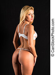 Blonde - Beautiful petite blonde woman in white lingerie on...