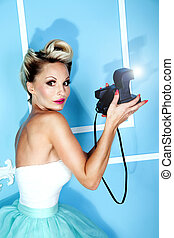Blonde beautiful woman photographing