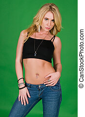 Beautiful young blonde in a black top and jeans