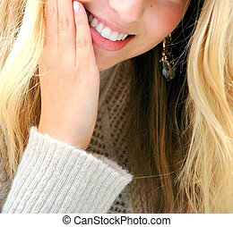 Blonde girl with beautiful smile.