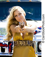 Blonde beauty gangster - Beauty in golden dress with toy gun...
