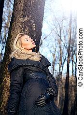 Blonde beauty posing in forest.
