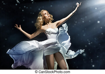 Blonde beauty posing over starry background