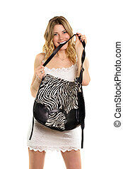 Blonde biting the strap of bag