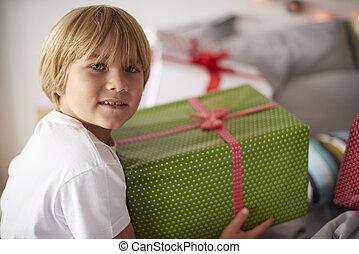 Blonde boy with big Christmas present