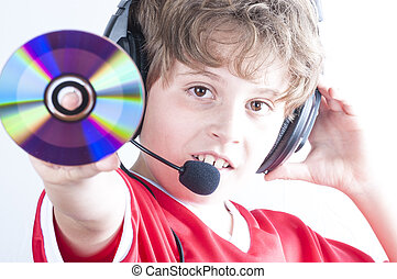 Blonde boy with music helmet on his head and musical records or cds in his hands
