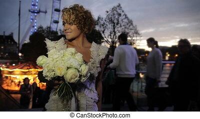 Blonde bride smiling at the camera
