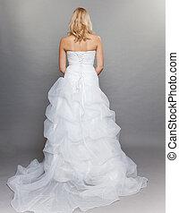 blonde bride white long wedding dress back view on gray