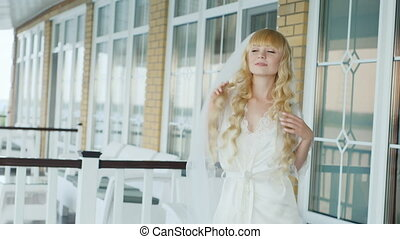 Blonde bride with blue eyes - she hops on the spot
