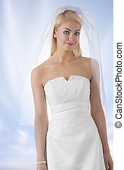 blonde bride with veil in front of the camera