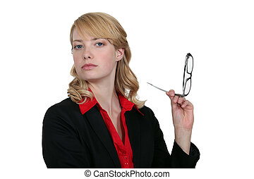 blonde businesswoman holding her head high up with glasses