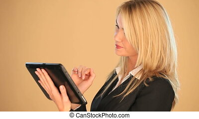 Blonde businesswoman on a tablet