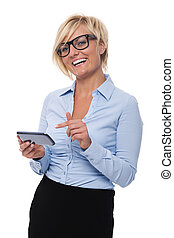 Blonde businesswoman smiling and pointing on mobile phone