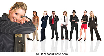 Blonde businesswoman standing in front of a business people grou